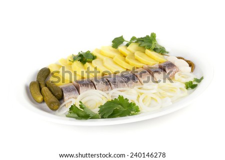 Portion of herring fish fillets with potato and onion - stock photo