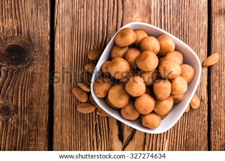 Portion of homemade Marzipan on rustic wooden background - stock photo