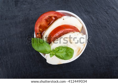 Portion of Mozarella with Tomatoes and Balsamico dressing (selective focus; close-up shot) - stock photo