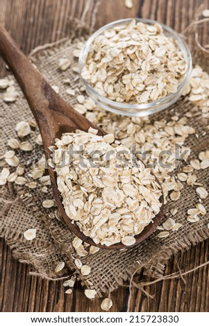 Portion of Oatmeal on a wooden spoon - stock photo