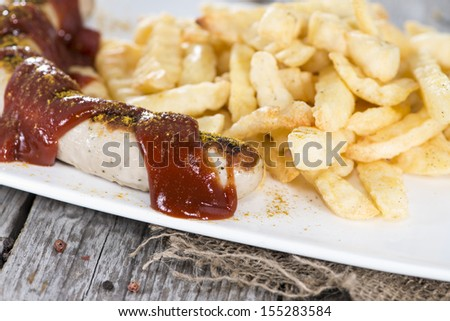 Portion of Original German Currywurst (close-up shot) - stock photo