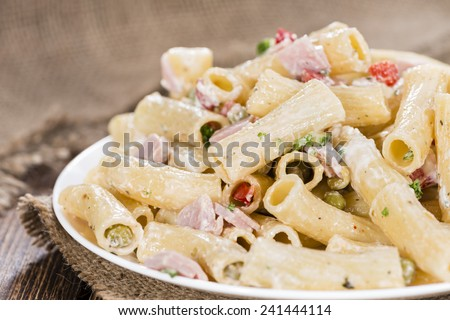 Portion of Pasta Salad (with mayonnaise) on wooden background - stock photo