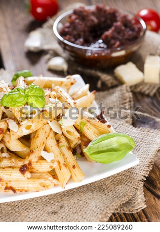 Portion of Penne with Tomato Pesto, Basil and Parmesan Cheese