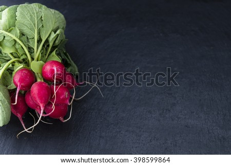 Portion of Radishes (selective focus, close-up shot) on a slate slab