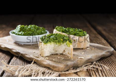Portion of Ramson Pesto on wooden background (close-up shot) - stock photo