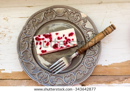 Portion of raspberry cheesecake