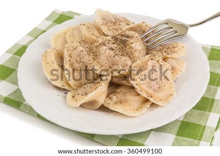 portion of ravioli (russian pelmeni) on green checkered napkin - stock photo