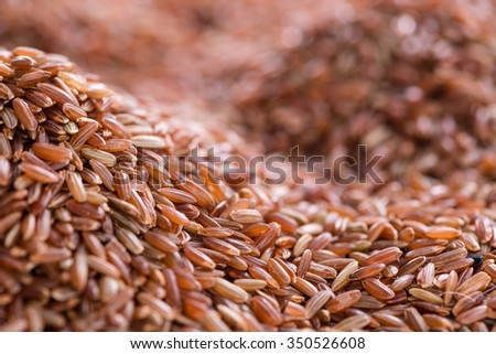 Portion of red Rice as detailed close-up shot for use as background image or as texture
