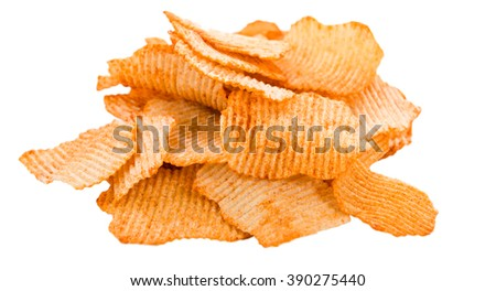 Portion of rippled Potato Chips (selective focus) on an wooden table - stock photo