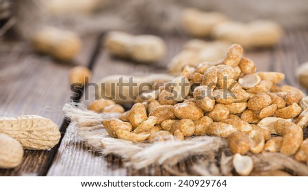 Portion of roasted Peanuts with spices and salt (close-up shot) - stock photo