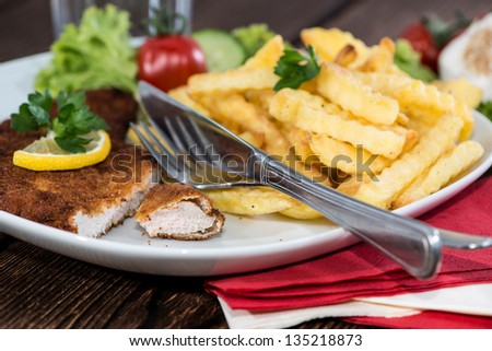 Portion of Schnitzel with Chips on a plate