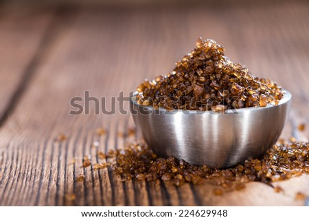Portion of Smoked Salt on wooden background - stock photo