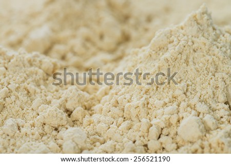 Portion of Soy Flour (detailed close-up shot) for use as background or ay texture - stock photo