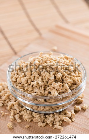 Portion of Soy Meat close-up shot (on wooden background) - stock photo