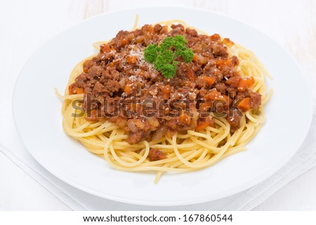 portion of spaghetti bolognese, top view, close-up - stock photo