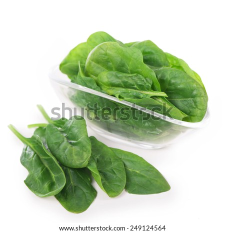 Portion of Spinach isolated on white background - stock photo
