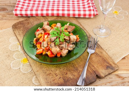 Portion of stew with grilled paprika as an attachment in the ethno restaurant - stock photo