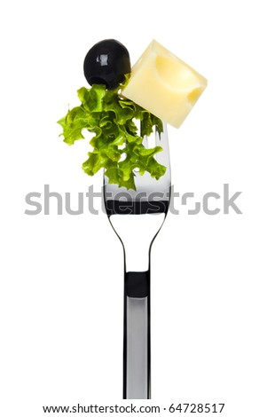 portion of swiss cheese, black olive and lettuce sticking on fork, isolated on white