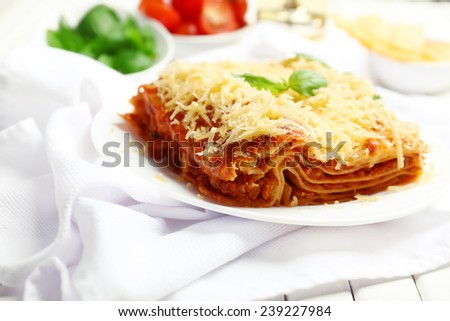 Portion of tasty lasagna on table - stock photo