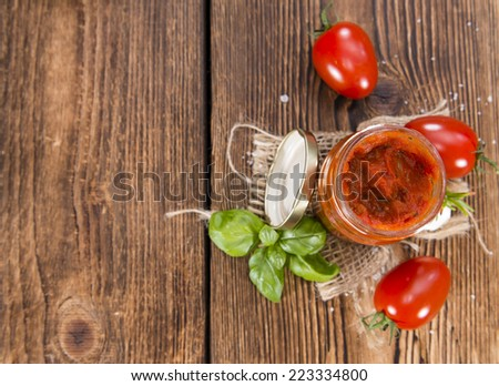 Portion of Tomato Sauce with Basil and Garlic (close-up shot) - stock photo