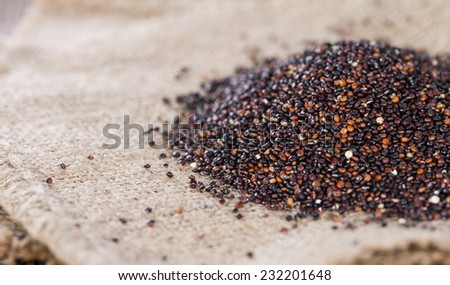 Portion of uncooked black Quinoa (detailed close-up shot) - stock photo