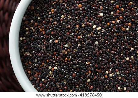 Portion of uncooked gluten free black Quinoa (detailed close-up shot). Superfood - stock photo