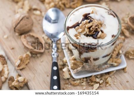 Portion of Walnut Yoghurt with Chocolate Sauce - stock photo