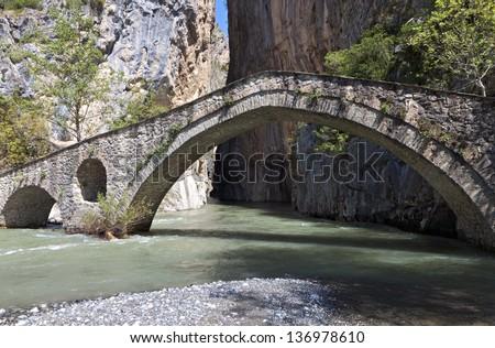 Portitsa gorge and the old stone bridge of Venedictos river near Grevena city in Greece - stock photo