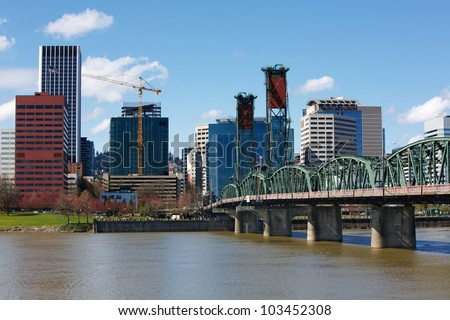 Portland City Green Steel Bridge and skyline with construction crane - stock photo