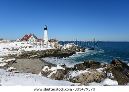 Portland Head Lighthouse and keepers' house in winter, Cape Elizabeth, Maine, USA - stock photo