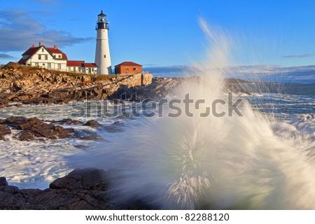 Portland Head Lighthouse Crashing Waves - stock photo