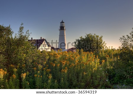 Portland head lighthouse in cape Elizebeth Maine at sunrise in late summer - stock photo