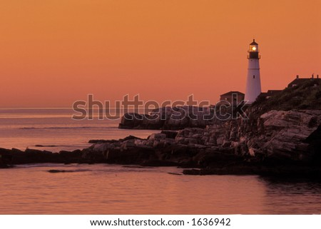 portland head lighthouse in casco bay in maine at dusk - stock photo