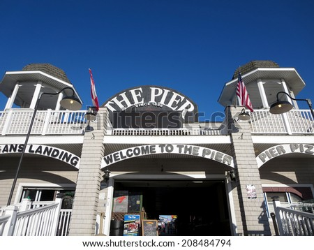 PORTLAND, MAINE - JUNE 3: Entrance to the Historic Old Orchard Beach Pier, which since 1898 has been one of main attractions in Maine.  Old Orchard Beach, Maine June 3, 2014. - stock photo