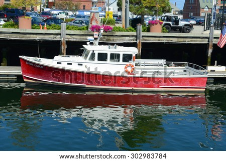 PORTLAND, ME - AUG 24: Fishing boat 'Lucky Catch' docked at Old Port on August 24th, 2014 in downtown Portland, Maine, USA. - stock photo