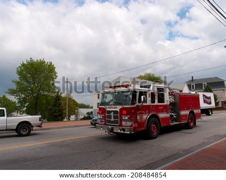 PORTLAND, ME -  MAY 27: Portland Firetruck races down street in the wrong direction to assist in emergency, Portland, Maine on 31 May 2014.