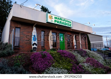 PORTLAND, OR - FEBRUARY 27, 2016: Marijuana Paradise a pot dispensary in Portland Oregon part of a string of retail drug stores that have popped up when Oregon passed a law to legalize marijuana. - stock photo