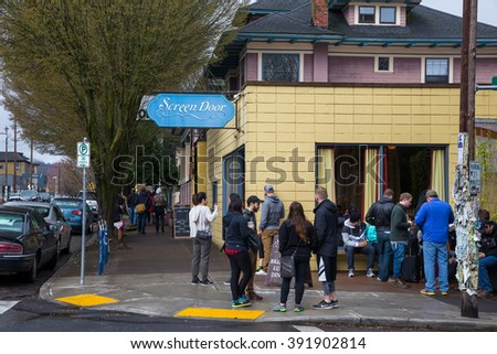 PORTLAND, OR - FEBRUARY 27, 2016: Poeple wait outside of the historic and vastly popular Screen Door restaurant in Portland Oregon.