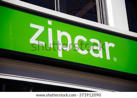 PORTLAND, OR - FEBRUARY 2, 2016: Zipcar sign in downtown PDX, a ride sharing company with electric and hybrid automobiles. - stock photo