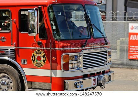 PORTLAND, OR - JULY 14, 2013: A fire engine responds to a medical emergency in the industrial areal of Portland Oregon on July 14th, 2013 - stock photo