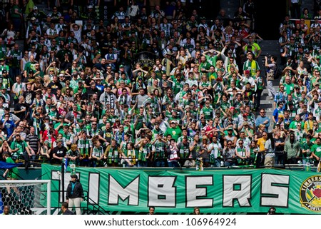 PORTLAND, OR - JUNE 24: Timbers Army shows support of the Portland Timbers team during Seattle Sounders vs. Portland Timbers game, on June 24, 2012 at Jeld-Wen Field in Portland, OR. - stock photo