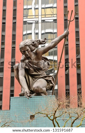 PORTLAND, OR - MARCH 8: Portlandia statue by Raymond J Kaskey dedicated October 8, 1985 sits at the entrance to the Portland Building welcoming guest to Portland Oregon on March 8, 2013