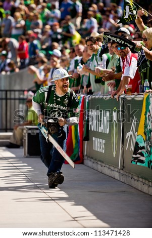 PORTLAND, OR - SEPT 15: Timber Joey revs up the fans with his chainsaw before the game Seattle Sounders vs Portland Timbers, on Sep 15, 2012 at Jeld-Wen Field in Portland, OR. - stock photo