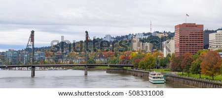 Portland Oregon city downtown waterfront park by Hawthorne Bridge in fall season panorama