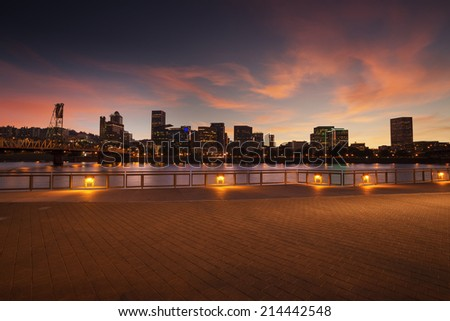 Portland, Oregon city skyline panorama with Hawthorne bridge. Beautiful twilight with pink clouds and light reflection on the Willamette river. - stock photo