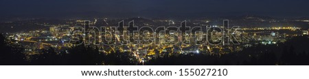 Portland Oregon Cityscape at Blue Hour with Silhouette of Mount Hood and Cascade Range Panorama - stock photo