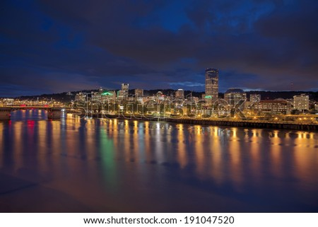 Portland Oregon Downtown City Skyline Along Willamette River Waterfront at Evening Blue Hour with Storm Clouds Panorama - stock photo