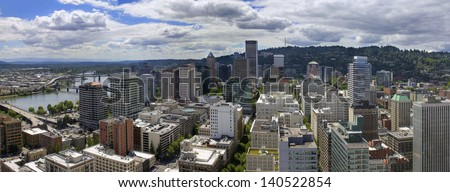 Portland Oregon Downtown Cityscape Aerial View with Cumulus Clouds Panorama - stock photo