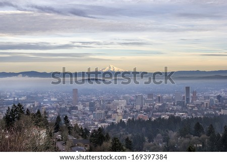 Portland Oregon Downtown Foggy Cityscape Skyline with Mount Hood at Sunset - stock photo