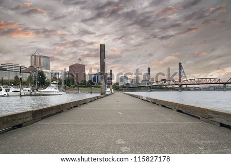 Portland Oregon Downtown Waterfront City Skyline by Willamette River Marina at Sunset - stock photo